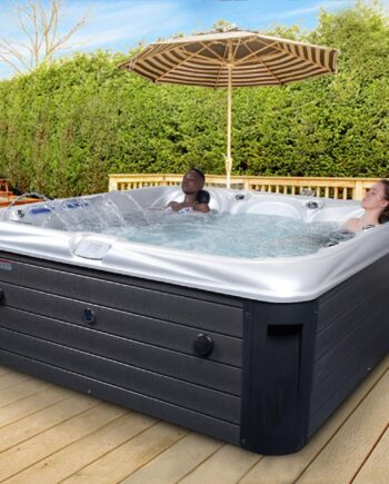 Girls in 6 seater luxury hot tub in the garden on outdoor decking
