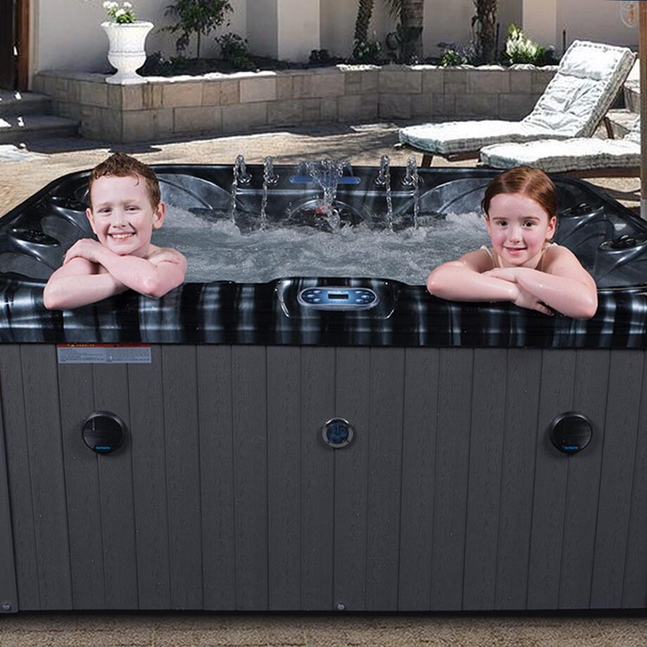 Children in luxury hot tub and relaxing in the garden outdoors